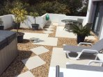 New porcelain tiles, sun beds & large table provides optional area for relaxation.