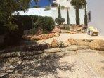 Dappled shade, beautifully kept garden, extra sun loungers provided.