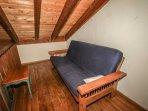 Futon in loft area upstairs