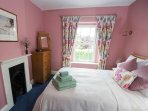 2nd bedroom with king size bed with hotel quality linen, soft downy duvets and pillows