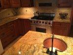 Kitchen island sink and Viking stove/oven