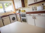 The kitchen is well equipped and has microwave, dishwasher and washing machine.