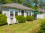 Front of the cottage with adirondack chairs
