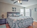Rest up in the spacious master bedroom with king-sized bed.