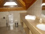 Bathroom on upper floor with shower cubicle and marble fittings