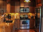 Updated spotless kitchen with beautiful granite counters and hard wood floors.