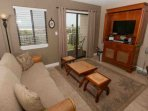 Living room with 32-inch TV/DVD and access to private balcony overlooking beach and Gulf