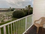 Furnished balcony with boardwalk, beach and Gulf views