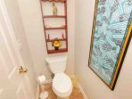 Half bath in hall with eclectic decor