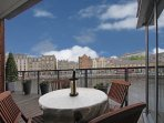 The large decked terrace with views over the Water of Leith and the Shore