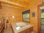 Jacuzzi Tub with a Forest View