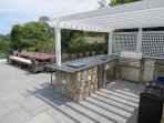 Here's a view of the outdoor kitchen and eating area that can seat 20-24 guests.