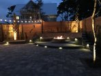Your private backyard with palm trees and remote controlled fire pit make a great place to enjoy!