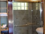 Glimpse of bathroom with tiled rain shower