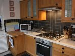 A modern fitted kitchen with Bosch appliances, electric oven & 5 burner gas hob.