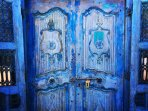 Hand carved hardwood doors rescued from a centuries old church welcome you to paradise