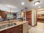 Features include: a French door refrigerator with ice maker, oven and stove, microwave, dishwasher, coffee maker...