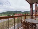 Off the living room, walk outside to your private balcony with spectacular mountain views and a two-person patio set.