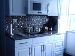 Kitchen with drip coffee maker or french press with Dunkin Donuts coffee
