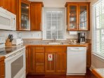 Kitchen comes equipped with dishwasher, fridge, toaster, blender, microwave, coffee maker, toaster, stove and oven
