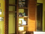 There is ample hanging room in the two cupboards and a selection of books in the library