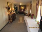 Entrance, parlor with piano, buffet serving table