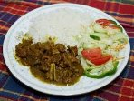 Curry Goat on a bed of white rice