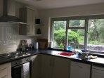 Lovely kitchen, brand new in 2016, overlooking the garden.