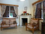 saloon with traditional cypriot style fire place