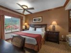 The large master bedroom suite, with spectacular mountain views of Canyons Resort and the Wasatch Mountain Range, is...