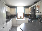 Modern fully equipped kitchen with double oven range cooker