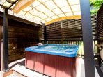 Hot Tub is Covered by a beautiful Lanai for enjoyment Rain or Shine!