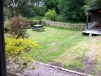 The garden viewed from the kitchen window. The grass is yellow because of recent drainage ditches.