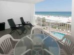 Private balcony with view of community pool, beach and Gulf