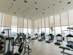 The gym room has full height glass with 360 degree view of the city.