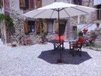 Umbrella and armchairs