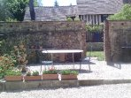 outdoor table and view on the kitchen garden . BBK