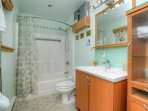 The bathroom features a shower/tub combo