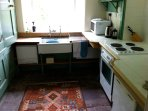 The kitchen is well equipped and looks out onto the picnic table and bbq