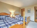 The queen-sized and twin-sized bed are equipped with cozy linens.