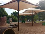 This Park is 1.6 Miles From the House & Features This Play Area, Tennis Courts, Pool and A Playscape