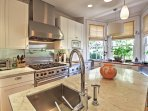 The lovely kitchen is fully equipped with stainless steel appliances.
