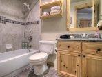 Guest bathroom w/granite countertops and beautifully tiled