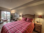 Master bedroom with queen bed and walkout to private deck w/great mountain views!