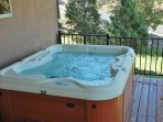 The 5 person hot tub awaits you w/ fantastic mountain views