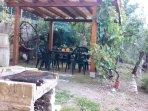 Barbeque,pergola,dondolo,chairs,in the garden