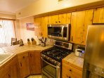 Open kitchen with new high tech stainless steel appliances