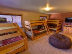Bunk Room with 3 twin over full bunk beds, en suite bathroom.
