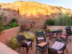 Lots of outdoor seating on the patio, nestled against one of Moab's famous rock fins!