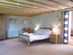 Spacious but cosy bedroom under the turf roof.